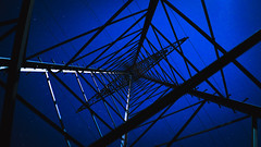 Electric power (Nathalie_Désirée) Tags: powerpole electricity fascinating perspective dream fantastic beautiful night sky stars starry nocturnal nocturne nocturn sonyalpha7r2 sonyalpha7rii sony28mmf20 creative angle metal scaffold framework tech technique power interesting interested focus amazing pylon pylons pattern hypnose hypnotic strommast evening dark darkness sonyαmo unusual unconventional engineering artistic unreal outdoors stupenda light shadow fascination up skyward skywards monument architecture mighty moonshine moonlit moonlight exploring nightwalk abstract form forms geometry geometric serenade future futuristic artificial pointofview pov deepblue bluetiful industrial industry