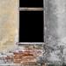 Brick wall with broken window