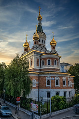 Whereabout? (Мaistora) Tags: church orthodox eastorthodox russian temple towers steeples domes gold golden gilded colourful color colour trees green street cars sky skyline skyscape sunset leica typ109 dlux lightroom luminar 4 luminar4 ai intelligent automated lazy kitsch postcard