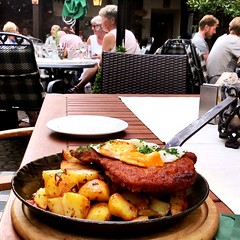 Tasty Schnitzel with potatoes and eggs - in Ruedesheim on the River Rhine in a Restaurant at the Market Place - Germany (DieterLo1) Tags: essen food meal schnitzel snitzel rüdesheim am rhein restaurant biergarten gastronomie bratkartoffel