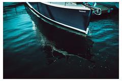 A Boat Reflecting on Water - At the Pier, Nova Scotia - Canada_Web 1_Scaled (johann.kisaame) Tags: atlantic blue canada fineart light luminance novascotia ocean reflection sailing sea shadows artistic boat ethereal maritime pier reflections ripples seas shore shoreline water
