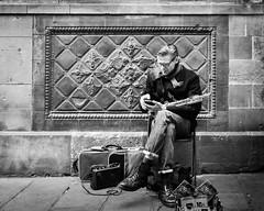 Musician on break (Sean X. Liu) Tags: streetphotography musician blackandwhite travel barcelona spain inhisowncorner