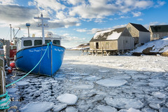 Icy Harbour (bluegreenorange) Tags: shack ns peggyscove peggyscovevillage water winter goldenhour clouds fishingboat ice novascotia