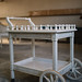 A serving wheel cart in white color with vintage setting