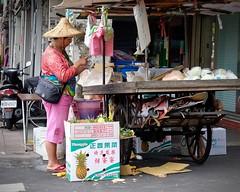 On the Streets of Taipei (Mondmann) Tags: taiwan taipei vendor streetvendor pineapples republicofchina asia asian woman street streetphotography taiwanese candid travel mondmann fujifilmxt10