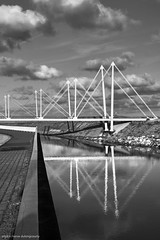 Passerelle du Grand Large (hervedulongcourty) Tags: bridge reflection ombre pont shadows cloud photography digue channel gateway photo shadow reflet leicam10p manualfocus malolesbains summiluxm50mmf14asph nb bw nuage leicam canal france leica sky passerelle blackandwhite summilux footbridge embankment ciel concrete europe dunkerque m10p ngc