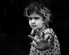 don't stop me (gro57074@bigpond.net.au) Tags: girl firstaustralian indigenous guyclift january 2020 black white bw mono monochrome monotone monochromatic nikon d850 tamron 2470mmf28 f40 portrait portraiture ochre face paint facepaint sydney cbd city circular quay don'tstopme