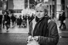 Blonde Ambition (Leanne Boulton) Tags: urban street candid portrait portraiture streetphotography candidstreetphotography candidportrait streetportrait streetlife woman female girl face eyes expression mood emotion feeling blonde cold winter weather scarf style fashion breeze tone texture detail depthoffield bokeh naturallight outdoor light shade city scene human life living humanity society culture lifestyle people canon canon5dmkiii 70mm ef2470mmf28liiusm black white blackwhite bw mono blackandwhite monochrome glasgow scotland uk