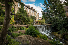 A village postcard (Through_Urizen) Tags: category citiestowns derbyshire england places waterfall sigma1020mm canon70d canon outdoor village uk unitedkingdom greatbritain waterfalls cascade stream rocks trees houses hills