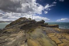 Location scouting... (muzzpix-nz) Tags: castlepoint lighthouse rock rockfeature rockformation rocks sea seascape seaside clouds cloudy aotearoa beach beachscene canoneosr