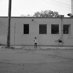 untitled (kaumpphoto) Tags: rolleiflex 120 tlr ilford hp5 wall brick street urban city minneapolis window road boy child alone solitude kid