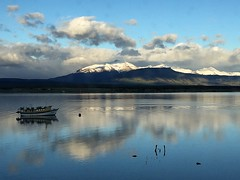 Reflections (halifaxlight) Tags: chile patagonia puertonatales mountains clouds daybreak boat reflections blue snow sea