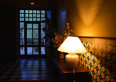 Feelings after Christmas (angelsgermain) Tags: entrance hall evening light interior door walls floor tiles furniture sidetable lamp decorations garden house hotel lafontdeloca lesplugadefrancolí concadebarberà catalonia catalunya