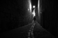 (cherco) Tags: man lonely light night solitario silhouette street luz alone architecture vanishingpoint monochrome composition canon blancoynegro blackandwhite perspectiva silueta silence way