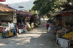 Kuang Si (MSM_K_JP) Tags: sony a6500 zeiss touit touit1832 planar luangphabang luangprabang laos kuangsi stores people