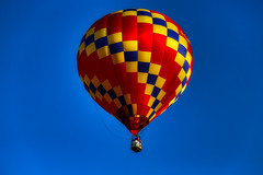 Around the World in 80 Days (Bombatron) Tags: colorful bright cheerful explore flickr hot air balloon blue red yellow sky skies no clouds canon 6d 24 105l