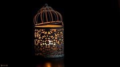 #Light - 7949 (✵ΨᗩSᗰIᘉᗴ HᗴᘉS✵89 000 000 THXS) Tags: light candle cage lowkey belgium europa aaa namuroise look photo friends be yasminehens interest eu fr party greatphotographers lanamuroise flickering challenge sigma sigmaart panasonic panasonicgx9
