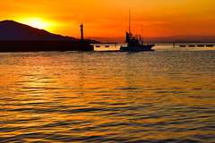 Departure (View from the rabbit hutch) Tags: pier ocean fishingfarm fishingboat fishingport wave sunset reflection silhouette seascape lighthouse