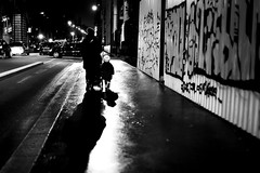 Against the pushchair (pascalcolin1) Tags: paris13 femme woman enfant child poucette pushchair nuit night lumière light ombre shade photoderue streetview urbanarte noiretblanc blackandwhite photopascalcolin 50mm canon canon50mm