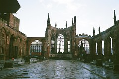 mjuii - cov cathedral ruins (johnnytakespictures) Tags: olympus mju mjuii mju2 stylusepic compact compactcamera film analogue fuji fujifilm superiaxtra400 coventry westmidlands winter cathedral religion religious christian catholic church ruin ruins historic historical cross statue monument dedication inside square cathedralruins