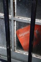 Is orange the common black ? (Tonton Gilles) Tags: barreaux fenêtre livre orange sale poussière gris détail urbain graphisme lignes