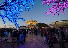 Christmas fair in Valletta (Jacek Rudowski) Tags: christmas fair valletta malta colorful lights trees blue sky illumination illuminated people market city architecture merrogoaround carousel tourism travel tourists winter