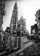 Cathedral in Antwerp, Belgium (` Toshio ') Tags: toshio belgium antwerp belgian europe europeanunion european history cathedral square city postcards tower catholic fuji store people cobblestone church blackandwhite bw canon7d canon 7d gothic clock unescoworldheritagesites unesco