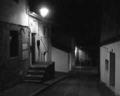 Roads of our lives (lebre.jaime) Tags: portugal beira covilhã architecture traditionalarchitecture nocturnal nightphotography analog film135 bw blackwhite noiretblanc nb pb pretobranco ptbw ilford delta3200 leicam3 summaron2835goggles epson v600 affinity affinityphoto