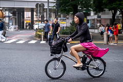 Tokyo 2019 (burnt dirt) Tags: shibuya tokyo japan asia japanese asian candid documentary street photography downtown metro urban city scramble crossing outdoor people person fujifilm xt3 fujinon 50mm f2 woman girl smile laugh train station style fashion bike bicycle life real crowd tourist emotion expression portrait close nippon pink hoodie whistle