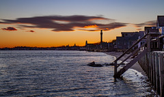 Provincetown Sunset (brucetopher) Tags: sunset city town historic waterfront cove shore coast coastal seacoast seashore ocean bay harbor cloud cloudscape pilgrimmonument monument tower flame flaming winter clouds sky skies