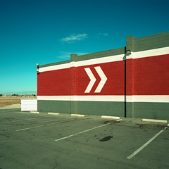 that way. lancaster, ca. 2018. (eyetwist) Tags: eyetwistkevinballuff eyetwist chevron arrows directions right parking bowling alley bowl lancaster california lanes strike wall arrow pointing building xpro film analog analogue mamiya6mf mamiya50mmf4l 50mm kodak ektachrome e100vs lenstagger kodakektachromee100vs crossprocessede6toc41 crossprocess crossprocessed mamiya 6mf ishootfilm emulsion mamiya6 square 6x6 mediumformat 120 ishootkodak 100vs epsonv750pro 6 cross process processed saturated contrast sign lines stripes angles type typography typographic lettering sansserif parkinglot sandsbowl palmdale mojavedesert desert antelopevalley graphic