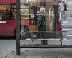 Man waiting at bus stop (Braca Stefanovic) Tags: streetphotography scene man waiting bus stop authentic city downtown europe glass life ordinary people red real street urban bracastefanovic belgrade serbia zemun