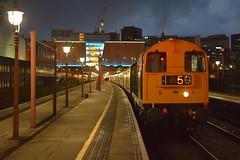 20189 heads the 16.43 Birmingham Moor St - Tysley 'Polar Express', with Black 5 N0.45305 on the rear. 08 12 2019 (pnb511) Tags: loco locomotive engine train carriages birminghammoorstreet birmingham diesel class20 night dark station lights primark