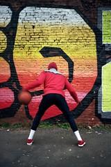 Dave (michel nguie) Tags: playground ball basket player analog portait redbricks michelnguie red orange man film vertical wall graffiti back hoodie rojo play workhard