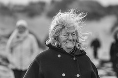 When the wind blows (Frank Fullard) Tags: frankfullard fullartd candid street portrait black white blanc noir windy weather hair achill dugort doogort mayo irish ireland monochrome lady seaside beach strand rnli fundraiser