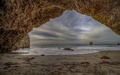 Cave Near High Tide (Michael F. Nyiri) Tags: elmatadorstatebeach cave rocks rockyshore california southerncalifornia beach pacificocean sea sky clouds