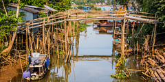 2019 - Vietnam-Avalon-Siem Reap - 19 - Mekong River Cu Lao Gieng (January) Island (Ted's photos - Returns Early February) Tags: 2019 avalonwaterways cropped culaogieng mekongriver nikon nikond750 nikonfx tedmcgrath tedsphotos vietnam vignetting boat boats stilts water reflection waterreflection bridge bridges sampan