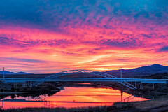 Sunrise over the Colorado River (j1985w) Tags: california arizona river sunrise reflection bridge hills sky clouds coloradoriver hdr oldtrailsbridge