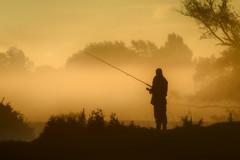 Dedham Angler, River Stour (Ed Thorn) Tags: dedham essex fishing angling fog sun rise mist river silhouette rod reel bank trees figure person nikon d3400 mood atmosphere