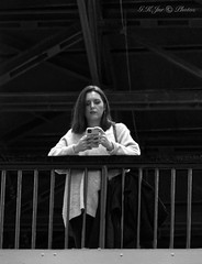 Girl On A Balcony-03369 (G.K.Jnr.) Tags: candid street streetphotography touristattraction interest people portraits strangers balcony girl younglady cellphone mobilephone monochrome bw blackandwhite blackwhite blackwhitephotos tatemodern london unitedkingdom fujix apsc xh1