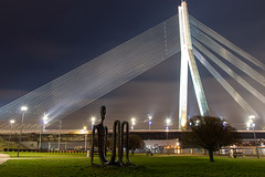 Vanšu bridge in Riga (JaaniicB) Tags: riga latvija latvia canon eos 77d sigma 1750mm f28 bridge vanšu wide angle europe winter green sculpture tree river daugava