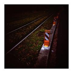railway into darkness (Armin Fuchs) Tags: arminfuchs holga velvia velvia100 6x6 mittelformat mediumformat 120mm square diagonal red dark lavillelaplusdangereuse würzburg
