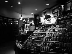 Sergio Leone would have love this glance (Aurélien B.) Tags: street buenosaires streetphotography man alone loneliness shop 24 7 night glance serious waiting chocolate light lights blackandwhite monochrome argentina noiretblanc