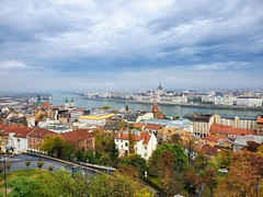 View of the Hungarian Parliament in Budapest (pierre_delage) Tags: budapest buda pest hungary sky urbanarea city town roof cloud cityscape daytime metropolitanarea architecture building tree house hill tourism mountain photography horizon landscape skyline autumn sunlight suburb vacation panorama river