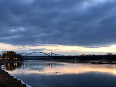 a high of 44 F today [the thawing river] (l i v e l t r a) Tags: iphonex lacrosse mississippiriver thaw melt sky bridge warmer 44degreesf reflection water evening wisconsin flowing