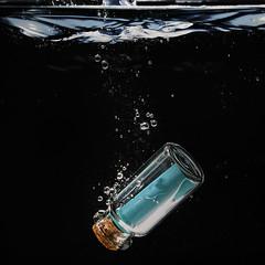 Old fashioned Whatsapp,... (Wim van Bezouw) Tags: bottle message sony ilce7m2 water splash highspeed pluto