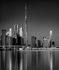 Desert Metropolis... (Aleem Yousaf) Tags: metropolis gotham city cityscape water front nikon nikkor 70200mm sunrise reflections lines telephoto long monochrome black white burj khalifa hotel address emaar damac proprty developers real estate big stopper lee neutral density filter skyscraper flickr morning shadows light smooth silky glass steel towers modern camera dawn pretty buildings architecture walk photography holidays uae united arab emirates glitter dubai skyline d850 zabeel