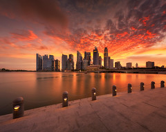 Classic Marina Bay Burn (Scintt) Tags: singapore wideangle traditional city cityscape hall marinabay rafflesplace tanjongpagar financial cbd central business district offices towers skyscrapers skyline sky clouds sun light contrast tones travel tourism architecture buildings urban modern exploration steps waterfront scintt scintillation jonchiangphotography fullerton bridge hotel expensive processed neutraldensity sony a7rii 1635 golden reflection clear sunset dusk evening iconic hny water lake pond reservoir cloud dramatic orange red glow longexposure slowshutter panorama stitched pano