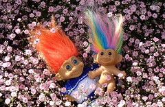 Happy Smiles..... (Lani Elliott) Tags: homegarden garden flowers pinkflowers smile toys yesteryear gypsophila lanisflowers lanisgarden lanielliott upclose closeup bokeh pinkbackground bright light pretty delightful cute