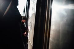 Twinkle in your eye (ewitsoe) Tags: moments nikon street warszawa winter erikwitsoe urban warsaw olderwoman tram entry commute pedestrian people ladies cinematic light shadow